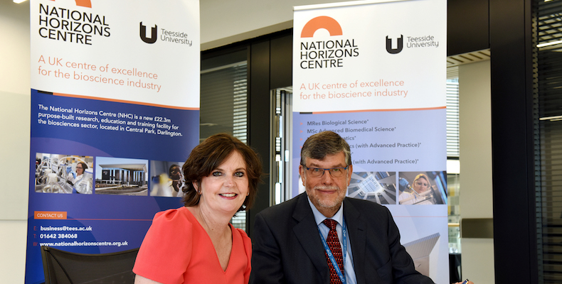 Prof Jane Turner, Teeside University's pro-vice-chancellor signs the new partnership with CPI's chief executive Nigel Perry